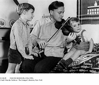 0110628 © Granger - Historical Picture ArchiveYEHUDI MENUHIN (1916-1999).   American violinist. Playing for his sons Gerard and Jeremy, 1954.