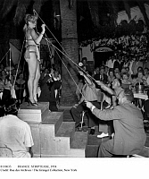0110633 © Granger - Historical Picture ArchiveFRANCE: STRIPTEASE, 1954.   Customers using fishing rods to strip a dancer at a cabaret in Juan-les-Pins on the French Riviera, 1954.