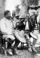 0110770 © Granger - Historical Picture ArchiveFRANCISCO 'PANCHO' VILLA   (1878-1923). Mexican revolutionary leader. Villa (left) sits and smokes with General Rodolfo Fierro during the Mexican Revolution, c1914.