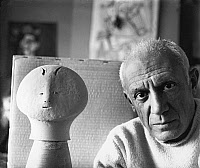 0110825 © Granger - Historical Picture ArchivePABLO PICASSO (1881-1973).   Spanish painter and sculptor. In his studio at Château Grimaldi, Antibes, on the French Riviera, with an early piece of his ceramic work, 1946. Photographed by Michel Sima.