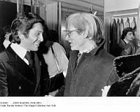 0110902 © Granger - Historical Picture ArchiveANDY WARHOL (1928-1987).   American artist and filmmaker. Warhol (right) with the Italian fashion designer Valentino at the opening of Valentino's boutique in Paris, France, 1976. Photographed by Giovanni Coruzzi.