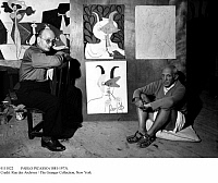 0111022 © Granger - Historical Picture ArchivePABLO PICASSO (1881-1973).   Spanish painter and sculptor. Picasso (right) in his studio at Château Grimaldi, Antibes, on the French Riviera, in 1946, with his friend, the Spanish poet Jaime Sabartés, seated in front of Picasso's depictions of Sabartés as a faun, as well as his painting 'Joy of Life' (left), still in progress. Photographed by Michel Sima.