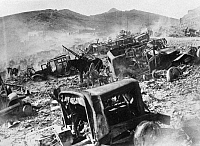 0111308 © Granger - Historical Picture ArchiveSPANISH CIVIL WAR, 1939.  Vehicles on the frontier in the Pyrenees mountains, destroyed by Republican (Loyalist) militia members fleeing to France after the Nationalist capture of Barcelona in January 1939.
