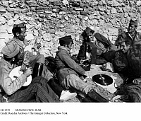0111339 © Granger - Historical Picture ArchiveSPANISH CIVIL WAR.   Nationalist soldiers relax listening to music on the gramophone, 20 November 1936.
