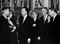 0111742 © Granger - Historical Picture ArchiveALBERT CAMUS (1913-1960).   French writer. Camus, third from left, and his wife, Francine, at a reception in Stockholm, Sweden, after he had been awarded the 1957 Nobel Prize for Literature. 1957.