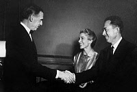 0111849 © Granger - Historical Picture ArchiveALBERT CAMUS (1913-1960).   French writer. At the Gallimard Publishing office in Paris, being congratulated by Swedish Ambassador Ragnar Kumlin for having received the1957 Nobel Prize for Literature. Camus' wife Francine Faure is also present. Photograph, 1957.