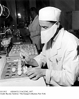 0111915 © Granger - Historical Picture ArchiveASIAN FLU VACCINE, 1957.   At the Pasteur Institute in Paris a technician removes eallantoic liquid from chicken embryos for the preparation of a vaccine against the Asian flu, September 1957.