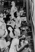 0111916 © Granger - Historical Picture ArchiveASIAN FLU, 1957.   Compulsory gargling at schools in Tokyo, Japan, during the flu epidemic, June 1957.
