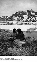 0112077 © Granger - Historical Picture ArchivePAUL-EMILE VICTOR   (1907-1995). French ethnologist and explorer. Kissing his companion Doumidia, a local Inuit, at Kangerdlugssuatsiak, East Greenland, autumn 1936.