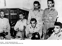 0112269 © Granger - Historical Picture ArchiveEGYPT: FREE OFFICERS, 1952.   The 'Free Officers' who overthrew King Farouk photographed at the time of the coup d'etat, 22-23 July 1952. Gamal Abdel Nasser, the leader, is seated, center, Anwar Sadat is on the extreme left, and Muhammad Naguib is seated right.
