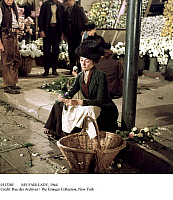 0112285 © Granger - Historical Picture ArchiveMY FAIR LADY, 1964.   Audrey Hepburn, as Eliza Doolittle, selling flowers at Covent Garden in London in a scene from the film version of 'My Fair Lady' directed by George Cukor, 1964.