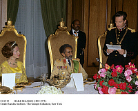 0112319 © Granger - Historical Picture ArchiveHAILE SELASSIE (1892-1975).   Emperor of Ethiopia, 1930-1974. The Emperor and Queen Fabiola of Belgium listen to King Baudouin's speech at a state dinner in Addis Ababa, 1972.