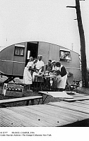 0112377 © Granger - Historical Picture ArchiveFRANCE: CAMPER, 1936.   The Freton family setting up a meal at their camper while vacationing on the Atlantic coast in 1936, at the time of the introduction of paid vacation time in France.