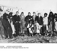 0112386 © Granger - Historical Picture ArchiveANTOINE DE SAINT-EXUPÉRY   (1900-1944). French aviator and writer. Saint-Exupéry (first European from left) photographed with other Frenchmen and Tuaregs in front of a Breguet 14 aircraft at Cape Juby in southern Morocco, 1928, while working as a pilot and station master for Aéropostale.