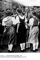 0112405 © Granger - Historical Picture ArchiveANNEXATION OF AUSTRIA, 1938.   German Chancellor Adolf Hitler being greeted by young Austrian girls in traditional costumes, on his arrival in Austria following Germany's annexation of the country on 12 March 1938.