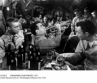 0112412 © Granger - Historical Picture ArchiveFROM HERE TO ETERNITY, 1953.   Montgomery Clift as Private Robert Prewitt playing the bugle, with Don Dubbins (left) and Frank Sinatra, in a scene from the 1953 film version of James Jones' novel 'From Here to Eternity,' directed by Fred Zinnemann.