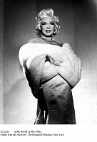 0112415 © Granger - Historical Picture ArchiveMAE WEST (1892-1980).   American actress. Wrapped in a fur stole, c1940.