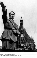 0112469 © Granger - Historical Picture ArchiveADOLF HITLER (1889-1945).   Chancellor of Germany, 1933-1945. Giving the Nazi salute from his car while passing the Frauenkirche in Nuremberg at the annual Nazi party rally, 5 September 1934.