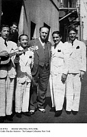 0112554 © Granger - Historical Picture ArchiveFRANK SINATRA (1915-1998).   American singer and actor. Sinatra (right) and other members of the group The Hoboken Four photographed in Los Angeles in 1936 with the manager of the theater where they were performing.