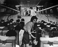 0112621 © Granger - Historical Picture ArchiveBOEING 707, c1960.   Interior of a Boeing 707 jet airliner, operated by Trans World Airlines, during a passenger flight, c1960, on which the 1956 film 'High Society,' starring Frank Sinatra, is being shown.