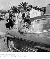 0112845 © Granger - Historical Picture ArchiveELLA FITZGERALD   (1917-1996). Waving to admirers as she leaves the airport in Nice, France, for Juan-les-Pins, where she will perform at the Antibes jazz festival, July 1964.
