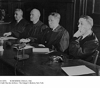0112876 © Granger - Historical Picture ArchiveNUREMBERG TRIALS, 1946.   American judges at the international trial of major World War II criminals at Nuremberg, Germany, October 1945-November 1946. From left: Donald Philips (South Carolina), Robert M. Toms (Michigan), Michael A. Musmanno (Pennsylvania) and John J. Speight (Alabama).