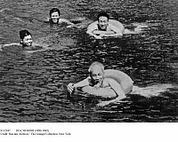0112947 © Granger - Historical Picture ArchiveHO CHI MINH (1890-1969).   Vietnamese political leader. President of the Democratic Republic of Vietnam, 1945-1969. 'Uncle Ho' swimming with young people, c1960.
