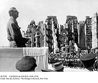 0113952 © Granger - Historical Picture ArchiveCHARLES de GAULLE (1890-1970).   French soldier and statesman. General de Gaulle addressing a crowd in Brest, on the coast of Brittany, as head of the Provisional Government of France, July 1945, with buildings in the background showing the damage sustained in the Allied liberation of the city from occupying German forces a year earlier, during World War II.