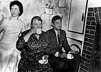 0131216 © Granger - Historical Picture ArchiveJOHN F. KENNEDY (1917-1963).   35th President of the United States. Kennedy having tea with a cousin, Mary Ryah (seated) and her daughter Josie, in his ancestral home of Dunganstown, Ireland, on 27 June 1963.