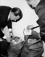 0134063 © Granger - Historical Picture ArchiveTRAIN ROBBERY.   50,000 pounds found in Southwark telephone box London may be part of loot the notes in two sacks were taken to Scotland Yard for examination december 11, 1963. Full credit: AGIP - Rue des Archives / Granger, NYC -- All righ