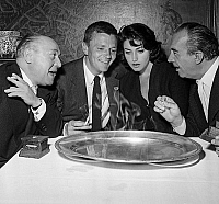 0134520 © Granger - Historical Picture ArchiveALBERT SIMONIN.   Team of film Le feu aux poudres : Albert Simonin (dialogues), Peter Van Eyck, Francoise Fabian (actors) and Henri Decoin (director) during diner at la Tour d'Argent restaurant, Paris, before filming, august 4, 1956. Full credit: AGIP - Rue des Archives / Granger, NYC -- All rights