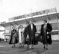 0134782 © Granger - Historical Picture ArchiveFRENCH MODELS, PARIS, 1952.   French models, ambassadors of french fashion, at Orly Paris airport before going in Near East, october 31, 1952 : models Stella and Capucine (foreground). Full credit: AGIP - Rue des Archives / Granger, NYC -- All Rights Reserved.