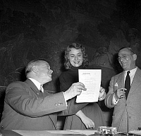 0135268 © Granger - Historical Picture ArchiveANNIE GIRARDOT.   Annie Girardot is engaged at Comedie Francaise in presence of Henri Rollan (her teacher on r) and Pierre Descaves july 16, 1954. Full credit: AGIP - Rue des Archives / Granger, NYC -- All rights reserved.