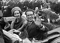 0136079 © Granger - Historical Picture ArchiveBAUDOUIN 1ER OF BELGIQUE AND FABIOLA.   King Baudouin and his fiancee Fabiola in convertible waving at the crowd, in front of the city Hall of Antwerp October, 22 1960. Full credit: AGIP - Rue des Archives / Granger, NYC -- All rights reser