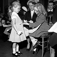 0136900 © Granger - Historical Picture ArchiveBRIGITTE FOSSEY.   young actress Brigitte Fossey attending child fashion show at Virginie's fabruary 26, 1953. Full credit: AGIP - Rue des Archives / Granger, NYC -- All rights res