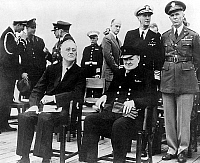 0138001 © Granger - Historical Picture ArchiveCHARTE OF L'ATLANTIQUE.   Franklin Delano Roosevelt, american president, and Winston Churchill, english prime minister, during their 1st meeting on american cruiser Augusta in the Atlantic in 1941. Behind them are standing admiral Ernest King, general Marshall. Full credit: AGIP - Rue des Archives / Granger, NYC -- All rights reserved.