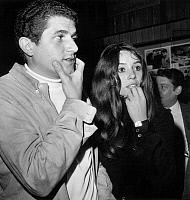 0138527 © Granger - Historical Picture ArchiveCLAUDE LELOUCH AND KIM COCHET.   French director Claude Lelouch with fiancee Kim Coche at premiere of film Les Gauloises Bleue august 29, 1968. Full credit: AGIP - Rue des Archives / Granger, NYC -- All rights reserved.