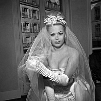 0138669 © Granger - Historical Picture ArchiveCOCCINELLE.   Coccinelle, transsexual comedian and singer (Jacques-Charles Dufresnoy) during fitting of her wedding dress march 13, 1962. Full credit: AGIP - Rue des Archives / Granger, NYC -- All Rights Reserved.