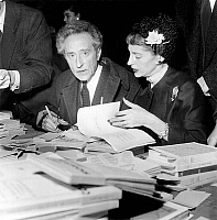 0138686 © Granger - Historical Picture ArchiveCOCTEAU AND WEISWEILLER.   Jean Cocteau, with friend Francine Weisweiller, signing book at the National Writers Committee fair november 11, 1955. Full credit: AGIP - Rue des Archives / Granger, NYC -- All rights reserved.