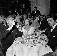 0138687 © Granger - Historical Picture ArchiveCOCTEAU AND WEISWEILLER.   Jean Cocteau (with Trinity ring by Cartier) and Francine Weisweiller in restaurant at the Lido cabaret december 13, 1957. Full credit: AGIP - Rue des Archives / Granger, NYC -- All rights reserved.