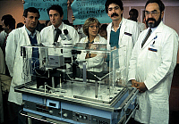 0139201 © Granger - Historical Picture ArchiveCOUVEUSE OF FECONDATION IN VITRO.   The team of in vitro fertilization in hospital in Clamart, France, celebrating the 100th test-tube baby on may 2, 1985 (2nd from l Rene Frydman, on r : Emile Papiernik) : the new incubator for test-tube baby. Full credit: AGIP - Rue des Archives / Granger, NYC -- All Rights Reserved.