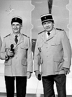 0139645 © Granger - Historical Picture ArchiveDE FUNES AND GALABRU.   actors Louis de Funes and Michel Galabru wearing policemen suits during tvprogram in 1982. Full credit: AGIP - Rue des Archives / Granger, NYC -- All rights