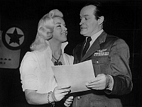 0139999 © Granger - Historical Picture ArchiveDIANA DORS.   The english actress Diana Dors look at the american actor Bob Hope on set of The Iron Petticoat fot the american tv show in Great Britain, january 18, 1956. Full credit: AGIP - Rue des Archives / Granger, NYC -- All rights res