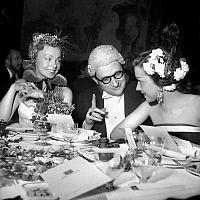 0140079 © Granger - Historical Picture ArchiveMASQUERADE BALL.   Dany Robin, Rene Floriot, Maria Riquelme dressed up at a masquerade ball and dinner. 25 May 1951. Full credit: AGIP - Rue des Archives / Granger, NYC -- All righ
