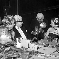 0140081 © Granger - Historical Picture ArchiveMASQUERADE BALL.   Dany Robin, Floriot, Maria Riquelme and a photographer in costume at a masquerade ball. 25 May 1951. Full credit: AGIP - Rue des Archives / Granger, NYC -- All Rights Reserved.