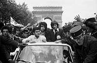 0140145 © Granger - Historical Picture ArchiveDOMINIQUE ROCHETEAU AND DOMINIQUE BATHENAY.   Footbal team AS st etienne back in france after the final, lost, of the champions league. They parade on champs Elysee to wild applause from the crowd, may 13, 1976. Here soccer players Dominique Rocheteau and Dominique Bathnay. Full credit: AGIP - Rue des Archives / Granger, NYC -- All rights reserved.