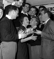 0140621 © Granger - Historical Picture ArchiveEDWIGE FEUILLERE.   french vocal group Les Compagnons de la Chanson with Edwige Feuillere and Pierre Louis celebrating saint Edwige on october 17, 1953. Full credit: AGIP - Rue des Archives / Granger, NYC -- All rights reserved.