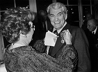 0140627 © Granger - Historical Picture ArchiveEDWIGE FEUILLERE AND JEAN MARAIS.   French actor Jean Marais receiving from Edwige Feuillere cross of officer of the french Legion d'Honneur, october 17, 1983. Full credit: AGIP - Rue des Archives / Granger, NYC -- All rights reserved.