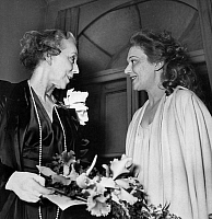 0140721 © Granger - Historical Picture ArchiveELISABETH OF BELGIQUE AND EDWIGE FEUILLERE.   Elizabeth of Wittelsbach (former queen of Belgium and former duchess of Bavaria) congratulating actress Edwige Feuillere after premiere of play Partage de midi december 17, 1948 in Paris. Full credit: AGIP - Rue des Archives / Granger, NYC -- All rights