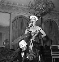 0140856 © Granger - Historical Picture ArchiveELSA SCHIAPARELLI.   Dress designer Elsa Schiaparelli wearing radish fancy fress at costume masked ball the gentleman is dressed as a mushroom march 24, 1949. Full credit: AGIP - Rue des Archives / Granger, NYC -- All rights reserved.